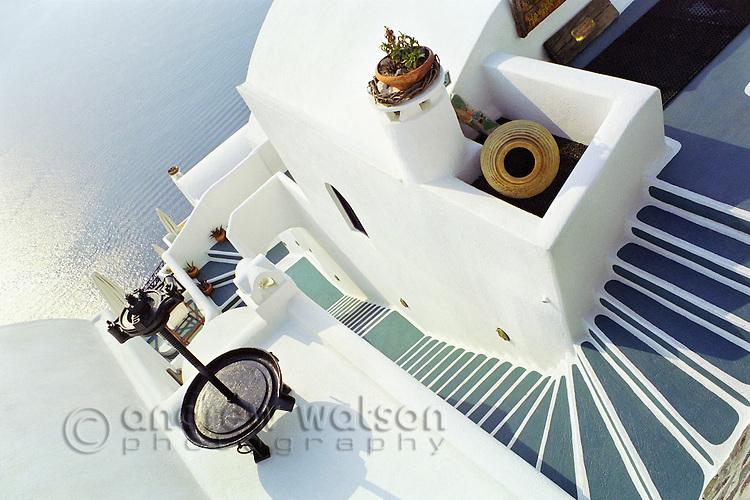 Vista of a whitewashed house overlooking the Aegean Sea.  Oia, Santorini, Greece