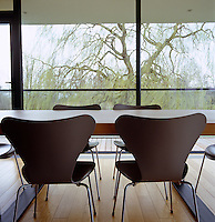 The dining room is furnished with Arne Jacobsen chairs and a Tissitana dining table