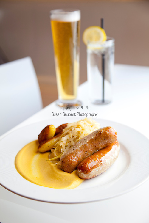 Leopold's Kafe brings together the aspects of the traditional European Café.  Austrian cuisine is their specialty from traditional dishes such as Schnitzel and Bratwurst as well as our house made pastries particularly, the Sacher Torte and the Esterhazy. Pictured here is the skillet cooked bratwurst, served with celery sauerkraut, roasted potatoes and mustard with an Eggenberg Pils beer.