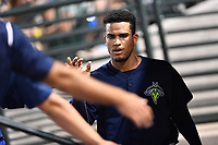 Starting pitcher Merandy Gonzalez (38) of the Columbia Fireflies is congratulated in the dugout in a game against the West Virginia Power on Thursday, May 18, 2017, at Spirit Communications Park in Columbia, South Carolina. Columbia won in 10 innings, 3-2. (Tom Priddy/Four Seam Images)