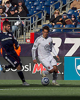 DC United forward Josh Wolff (16) dribbles as New England Revolution defender Franco Coria (2) closes. In a Major League Soccer (MLS) match, the New England Revolution defeated DC United, 2-1, at Gillette Stadium on March 26, 2011.
