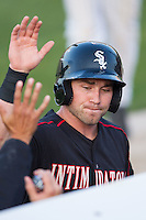 Kale Kiser (9) of the Kannapolis Intimidators high fives teammates after scoring a run against the Hickory Crawdads at CMC-Northeast Stadium on May 19, 2014 in Kannapolis, North Carolina.  The Crawdads defeated the Intimidators 10-6.  (Brian Westerholt/Four Seam Images)