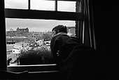 Tenant of a short-life flat in Culross Buildings overlooking the oldgoods yard site behind King's Cross station, London 1990.