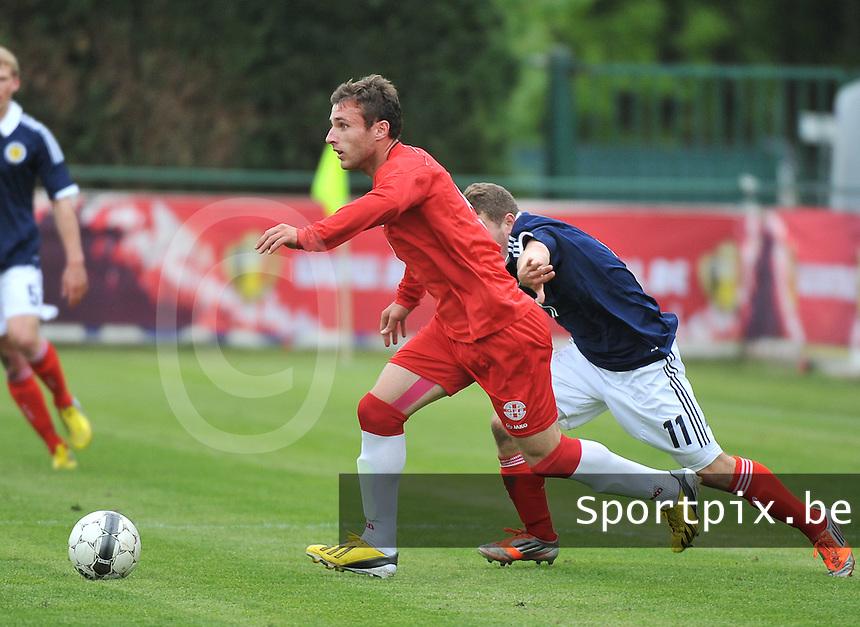 Scotland U19 - Georgia U19 : Levan Gegetchkori (5) and Ryan Fraser (11).foto DAVID CATRY / Nikonpro.be