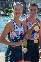 """Henley on Thames, United Kingdom, 3rd July 2018, Saturday,  """"Henley Royal Regatta"""",  Leander Club Olympians, celebrating Leander 200 year row past, showing Olympic medals, left Victoria (Vicky) THORNLEY, right Pete REED  View, Henley Reach, River Thames, Thames Valley, England, UK."""