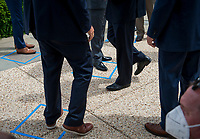 Republican members of Congress arrive and stand outside of the safe distancing squares identified on the pavement, prior to House Minority Leader Rep. Kevin McCarthy's (R-Calif.) press conference with House Minority Whip Rep. Steve Scalise (R-LA), House GOP Conference Chairwoman Liz Cheney (R-WY) and others, to announce that Republican leaders have filed a lawsuit against House Speaker Nancy Pelosi and congressional officials in an effort to block the House of Representatives from using a proxy voting system to allow for remote voting during the coronavirus pandemic, outside of the U.S. Capitol in Washington, DC., Wednesday, May 27, 2020. Credit: Rod Lamkey / CNP/AdMedia