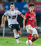 (L) Pierre-Emile Hojbjerg of Bayern Munich competes for the ball with (R) Wang Junhui of Guangzhou Evergrande during the Bayern Munich vs Guangzhou Evergrande as part of the Bayern Munich Asian Tour 2015  at the Tianhe Sport Centre on 23 July 2015 in Guangzhou, China. Photo by Aitor Alcalde / Power Sport Images