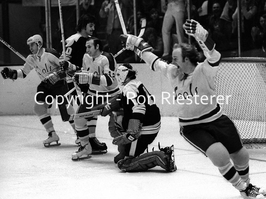 Seals Stan Gilbertson and Gary Jarrett celebrate goal against Boston golie Ed Johnston. (1971 photo/Ron Riesterer)