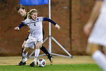 GREENSBORO, NC - DECEMBER 02: Shay Quintin #4 of Messiah College breaks away from Peder Nalum Olsen #30 of North Park University during the Division III Men's Soccer Championship held at UNC Greensboro Soccer Stadium on December 2, 2017 in Greensboro, North Carolina. Messiah College defeated North Park University 2-1 to win the national title. (Photo by Grant Halverson/NCAA Photos via Getty Images)