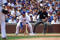 Chicago Cubs third baseman Kris Bryant (17) waits for a throw as umpire Tripp Gibson gets in position to make a call during a game against the Milwaukee Brewers on August 13, 2015 at Wrigley Field in Chicago, Illinois.  Chicago defeated Milwaukee 9-2.  (Mike Janes/Four Seam Images)
