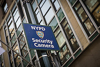 A sign warning that NYPD security camera are installed in the area is pictured in the New York City borough of Manhattan, NY, Monday May 12, 2014.