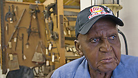 Lawrence Williams talks with his friends in the historical museum at the Knox County Fair in Mt. Vernon, Ohio.<br />