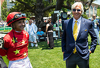ELMONT, NY - JUNE 10: Abel Tasman trainer Bob Baffert (R) and jockey Mike Smith (L) stand in the paddock before the Acorn Stakes on Belmont Stakes Day at Belmont Park on June 10, 2017 in Elmont, New York (Photo by Jesse Caris/Eclipse Sportswire/Getty Images)