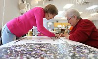 Lynn Gnadt (left) and Erma Newman begin a puzzle Tuesday, January 14, 2020, at the Farmington Senior Activity and Wellness Center. The two began a 1,000 piece puzzle titled Weekend Retreat. Check out nwaonline.com/200115Daily/ and nwadg.com/photos for today's photo gallery.<br /> (NWA Democrat-Gazette/David Gottschalk)