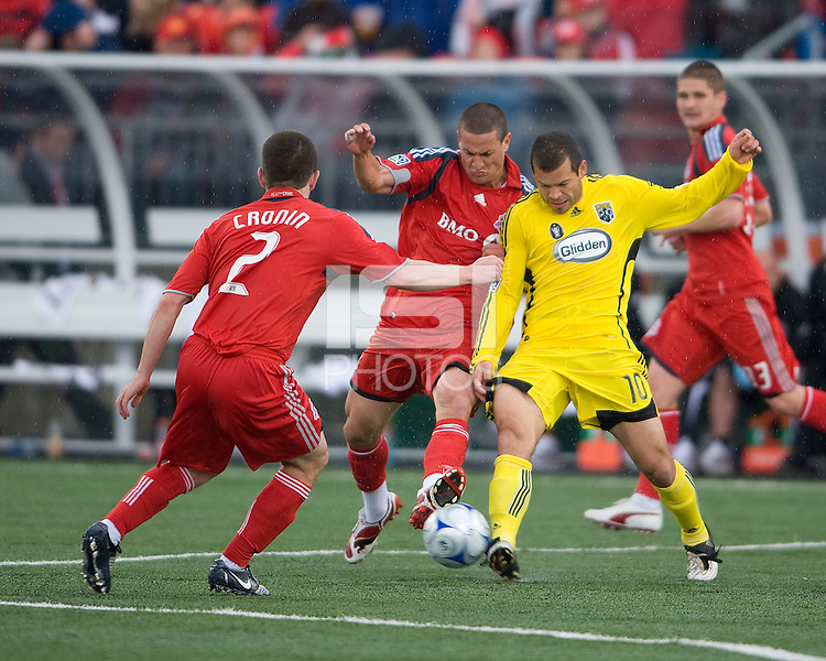 2 May 2009: Columbus Crew midfielder Emmanuel Ekpo #17 and Toronto FC defender Marco Velez # 4 battle for a ball as Toronto FC midfielder Sam Cronin #2 looks on at BMO Field in Toronto in a  game between the Columbus Crew and Toronto FC..The game ended in a 1-1 draw.