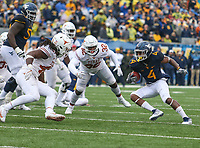 Morgantown, WV - November 18, 2017: West Virginia Mountaineers running back Kennedy McKoy (4) runs the ball during game between Texas and WVU at  Mountaineer Field at Milan Puskar Stadium in Morgantown, WV.  (Photo by Elliott Brown/Media Images International)