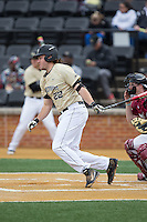 Will Craig (22) of the Wake Forest Demon Deacons follows through on his swing against the Harvard Crimson at David F. Couch Ballpark on March 5, 2016 in Winston-Salem, North Carolina.  The Crimson defeated the Demon Deacons 6-3.  (Brian Westerholt/Four Seam Images)