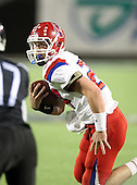 Manatee Hurricanes quarterback Cord Sandberg #24 heads towards the sideline on a 12 yard TD run in the first quarter of the Florida High School Athletic Association 7A Championship Game at Florida's Citrus Bowl on December 16, 2011 in Orlando, Florida.  The score at halftime is Manatee 17 - First Coast 0.  (Photo By Mike Janes Photography)