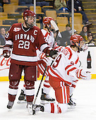 Chris Huxley (Harvard - 28), Alex Chiasson (BU - 9) - The Harvard University Crimson defeated the Boston University Terriers 5-4 in the 2011 Beanpot consolation game on Monday, February 14, 2011, at TD Garden in Boston, Massachusetts.