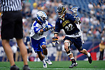 FOXBORO, MA - MAY 28: Tim Towler (22) of the Merrimack Warriors races by Clark Walter (10) of the Limestone Saints during the Division II Men's Lacrosse Championship held at Gillette Stadium on May 28, 2017 in Foxboro, Massachusetts. (Photo by Larry French/NCAA Photos via Getty Images)