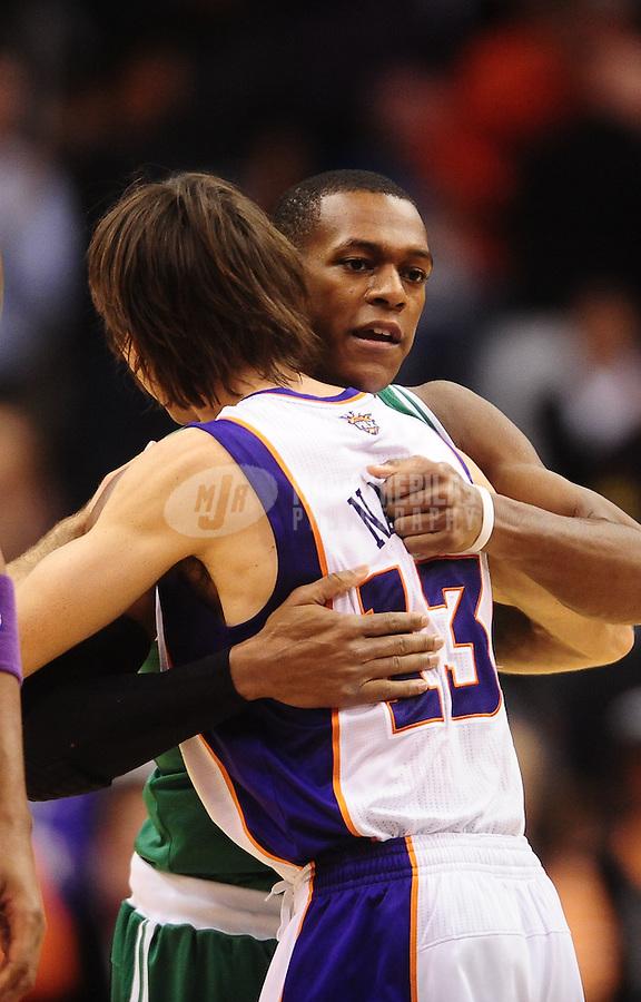 Jan. 28, 2011; Phoenix, AZ, USA; Boston Celtics guard Rajon Rondo (9) hugs Phoenix Suns guard (13 Steve Nash at the US Airways Center. Mandatory Credit: Mark J. Rebilas-