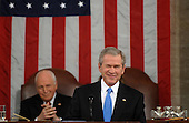 US President George W. Bush winks to a member of the audience before he delivers the final State of the Union address of his presidency at the US Capitol in Washington 28 January 2008.     .Credit: Tim Sloan - Pool via CNP