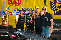 Sep 29, 2019; Madison, IL, USA; NHRA top fuel driver Billy Torrence celebrates with wife Kay Torrence and son Steve Torrence after winning the Midwest Nationals at World Wide Technology Raceway. Mandatory Credit: Mark J. Rebilas-USA TODAY Sports