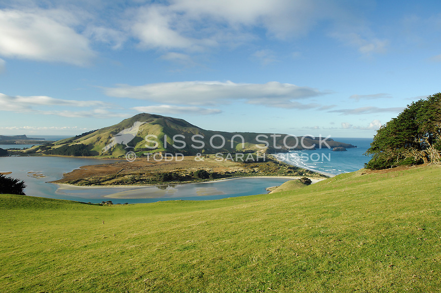 a sunny day view from sandymount on Otago Peninsula - looking towards hoopers inlet and Victory Beach.
