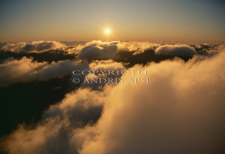 Aerial of sunset over clouds. New Zealand.