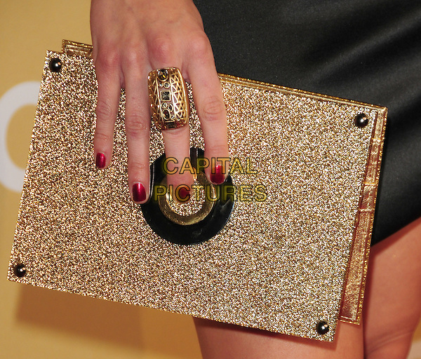 ANNALYNNE McCORD's bag .at The 3rd Annual CNN Heroes: An All-Star Tribute held at The Kodak Theatre in Hollywood, California, USA,  November 21st 2009                                                                   .detail hand gold ring clutch bag .CAP/RKE/DVS.©DVS/RockinExposures/Capital Pictures