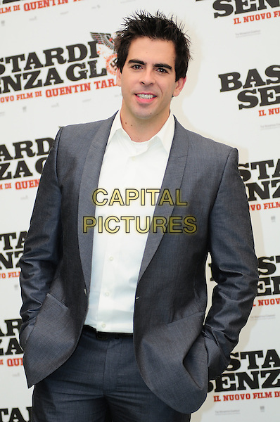 ELI ROTH.Photocall for 'Inglorious Basterds', Rome Hotel Hassler, Italy.September 21st, 2009.half length suit jacket shirt hands in pockets white grey gray.CAP/CAV.©Luca Cavallari/Capital Pictures.