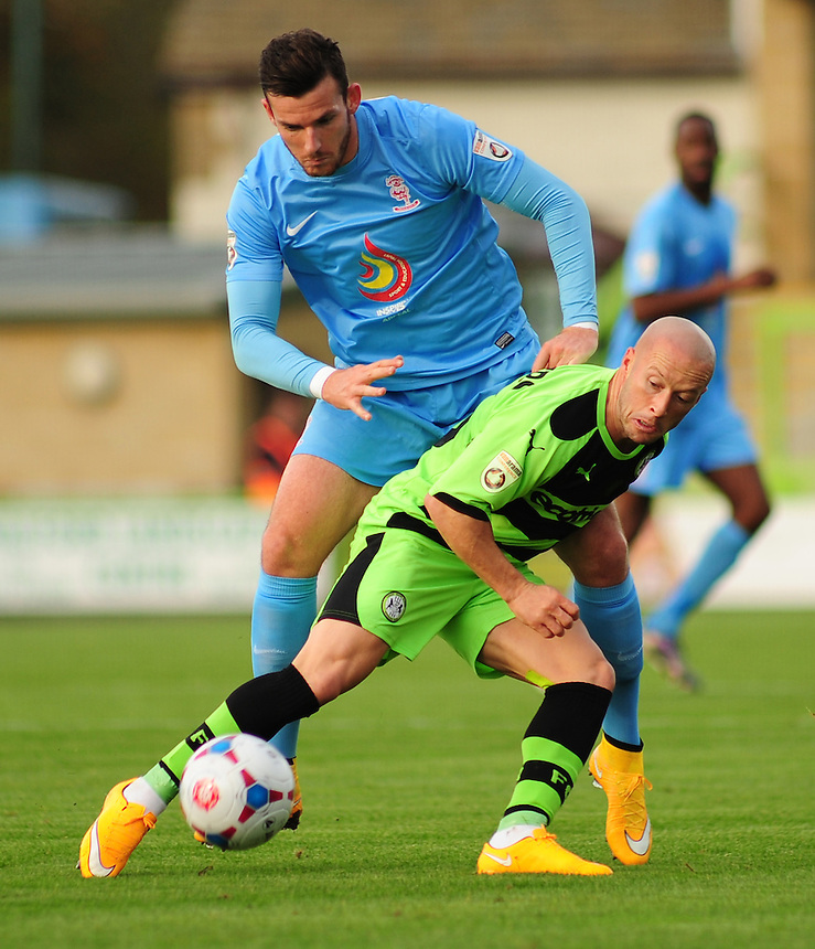 Lincoln City's Sean Newton battles for possession with Forest Green Rovers' Luke Rodgers<br /> <br /> Photo by Andrew Vaughan/CameraSport<br /> <br /> Football - English Football Vanarama Conference Premier League - Forest Green Rovers v Lincoln City - Saturday 1st November 2014 - The New Lawn - Nailsworth<br /> <br /> &copy; CameraSport - 43 Linden Ave. Countesthorpe. Leicester. England. LE8 5PG - Tel: +44 (0) 116 277 4147 - admin@camerasport.com - www.camerasport.com