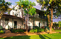 Late afternoon light falls on the original missionary home and museum of the Rev. Dwight Baldwin. Built in 1834, it can be seen and visited on Front Street in Lahaina.