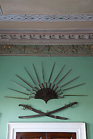 Above the doors in the hall are bayonet racks dating from the 1780s