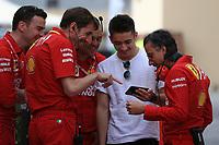 3rd December 2019; Yas Marina Circuit, Abu Dhabi, United Arab Emirates; Pirelli Formula 1 tyre testing sessions; Scuderia Ferrari, Charles Leclerc shares his phone display with Laurent Mekies, Sporting Director of Scuderia Ferrari and other members of the Ferrari team