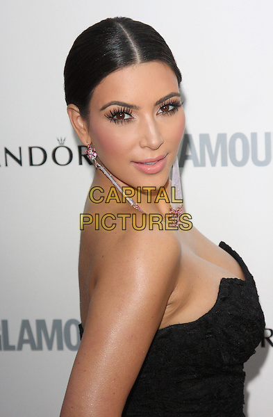 Kim Kardashian.The Glamour Women of the Year Awards 2011 - inside arrivals London, England..June 7th, 2011.half length beauty hair up cleavage pink strapless patterned dangly earrings black headshot portrait.CAP/ROS.©Steve Ross/Capital Pictures