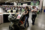 November 15, 2008. Fayetteville, NC..One thousand Army wives and active duty soldiers pregnant with what the locals call ?surge babies? were celebrated at the biggest military baby shower ever. These babies were conceived when.troops from the 82nd Airborne Division, deployed to Iraq for the surge of forces in January 2007, began returning home to Fort Bragg in November.. Billed as Boots and Booties the event was to capacity after 4 days of advertising.