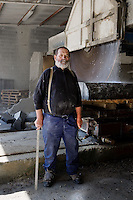 Pierre Gavazzi, stonemason (tailleur de pierre) poses for the photographer at Annot quarry, Annot, France, 26 April 2010