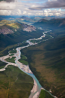 Aerial of the John River flowing out of the Brooks Range mountains, Gates of the Arctic National Park in the distance, Arctic, Alaska.