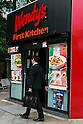 A man walks past a combined Wendy's and First-Kitchen joint fast food restaurant in Ueno on May 24, 2016, Tokyo, Japan. Japanese beverage manufacturer Suntory Holdings Ltd. announced on Monday that it will sell its shares in the First-Kitchen Ltd. hamburger chain to Wendy's Japan LLC. The First-Kitchen chain, which was launched in 1977, operates some 135 outlets in the Tokyo metropolitan area and western Japan and had sales of ¥8.7 billion ($79 million) in 2015. Wendy's plans to keep the First-Kitchen brand after the acquisition and operate joint branded restaurants. (Photo by Rodrigo Reyes Marin/AFLO)