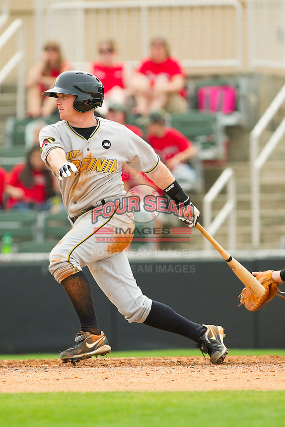 Kevin Mort #5 of the West Virginia Power follows through on his swing against the Kannapolis Intimidators at Fieldcrest Cannon Stadium on April 20, 2011 in Kannapolis, North Carolina.   Photo by Brian Westerholt / Four Seam Images