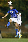 31 October 2013: Duke's Kim DeCesare (19) and North Carolina's Crystal Dunn (behind). The University of North Carolina Tar Heels hosted the Duke University Blue Devils at Fetzer Field in Chapel Hill, NC in a 2013 NCAA Division I Women's Soccer match. North Carolina won the game 3-0.