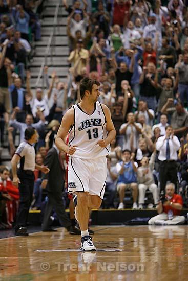Salt Lake City - Utah Jazz vs. Houston Rockets, game 6, NBA playoffs first round. Utah Jazz center Mehmet Okur (13), of Turkey, after hitting a three-pointer
