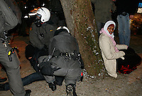 Police deal with arrested people. Pro-Palestinian protesters clashed with police as they held another demonstration against Israel in the Norwegian capital Oslo. Violent clashes lasted for hours  in the centre of Oslo. Israeli forces began a series of air strikes on the Gaza Strip on the 27th of December in retaliation against Hamas rockets fired into Israel. After eight days of bombardment, leaving over 400 Palestinians and four Israelis dead, Israeli tanks launched a ground invasion on the 4th of January.