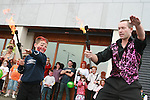 Dean Kenny Walsh juggles fire at the Drogheda Leisure Park Fun Day...Photo NEWSFILE/Jenny Matthews.(Photo credit should read Jenny Matthews/NEWSFILE)....This Picture has been sent you under the condtions enclosed by:.Newsfile Ltd..The Studio,.Millmount Abbey,.Drogheda,.Co Meath..Ireland..Tel: +353(0)41-9871240.Fax: +353(0)41-9871260.GSM: +353(0)86-2500958.email: pictures@newsfile.ie.www.newsfile.ie.FTP: 193.120.102.198.