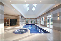 BNPS.co.uk (01202 558833)<br /> Pic: Sothebys/BNPS<br /> <br /> ***Please use full byline***<br /> <br /> Warrenbayne, a Palladian style house on St  George's Hill private estate near Weybridge, Surrey. On the market for a whopping &pound;12.5m. <br /> <br /> To the Manor Reborn...<br /> <br /> Britain's super rich are turning their backs on the decaying stately piles beloved by the aristocracy and building brand new modern mansions on their country estates.<br /> <br /> Rather than investing in the leaky roofs and draughty windows of days gone by, modern millionaires are choosing to build plush pads from the ground up.<br /> <br /> And they are filling their dream homes with every conceivable luxury without the need for a bottomless sink fund to pay for the costly upkeep of older houses.<br /> <br /> Estate agents specialising in top-end properties have reported a clear swing from grand Victorian manor houses to state of the art modern homes kitted out with all the mod cons.<br /> <br /> The multi-million pounds properties have been popping up across the country over the past few years - and are now being heralded as the stately homes of the future.