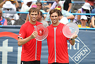Washington, DC - August 9, 2015:   Bob Bryan (USA) (right) and Mike Bryan  (USA) (left) pose with their trophies after winning the Citi Open men's doubles final at Rock Creek Park Tennis Center in Washington, DC  August 9, 2015.  (Photo by Elliott Brown/Media Images International)