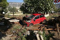 Pictured: Fallen trees and a car blocks a road which was caused by heavy rain in the area of Kinetta, near Athens, Greece. Monday 25 November<br /> Re: Heavy overnight rainfall has caused flooding and landslides in parts of Greece.
