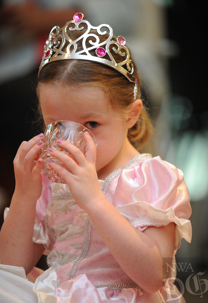 NWA Media/ANDY SHUPE - Hollan McCauley 4, of Bentonville sips her tea during the annual Sparkler Tea Party Monday, June 23, 2014, at the Fayetteville Public Library. Hollan was in town enjoying the event with her grandmother, who lives in Fayetteville. The event began with a few stories before tea was served. The parties continue today by reservation.