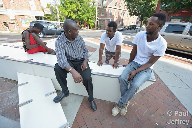 Joseph Shilalo, an employment specialist with Church World Service in Lancaster, Pennsylvania, talks with newly arrived refugees outside his office.<br /> <br /> Photo by Paul Jeffrey for Church World Service.